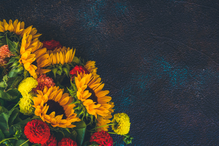 Dahlia and sunflowers on dark blue background, retro toned 写真素材