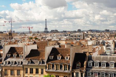 skyline of Paris with parisian roofs and Eiffel Tower, Paris France Stock fotó