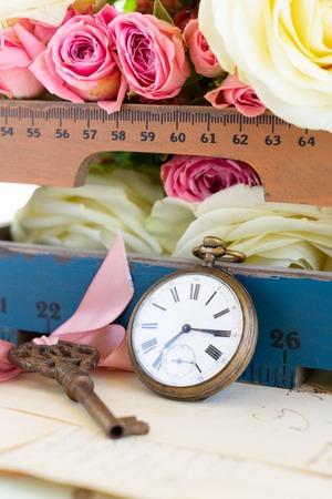 antique vintage pocket clock and fresh flowers