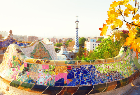 cityscape of Barcelona with bench of park Guell at fall day, Spain, toned