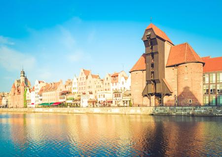 Zuraw oldest crane and old embankment, Gdansk , Poland, retro toned Archivio Fotografico