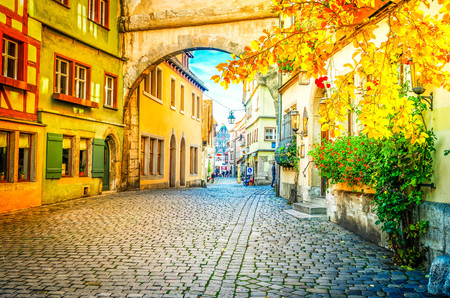 Roderbogen arch in Rothenburg ob der Tauber, Germany at fall, retro toned