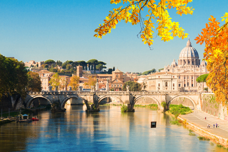 St. Peters cathedral over bridge and river water at autumn day Rome, Italy