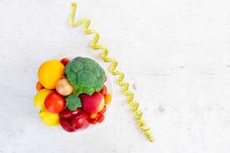 raw vagetables on white table - healty diet nutrition concept