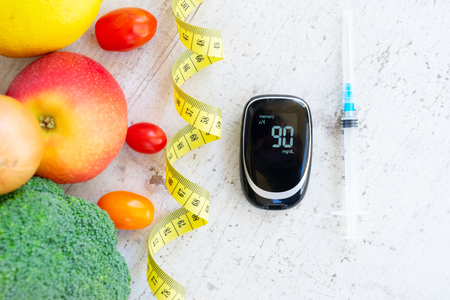 raw vegetables with blood glucose meter and insulin syringe, diabetes healthy diet concept