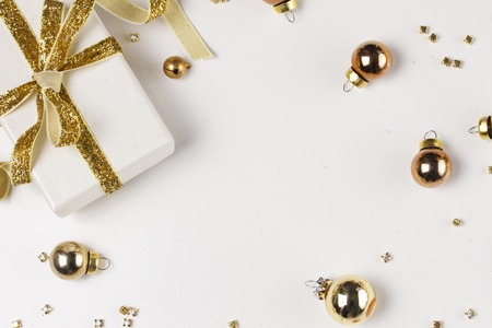 Christmas flat lay frame with git box with golden bow on white background Stock Photo