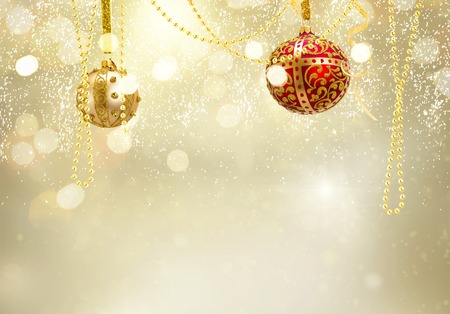 Golden christmas balls garland on glowing golden background with copy space
