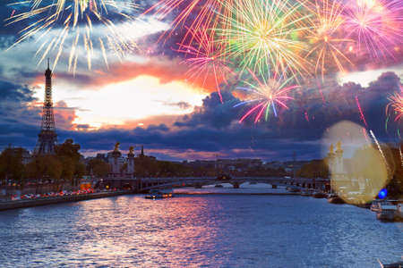 Alexandre III Bridge and Eiffel tower at night with fireworks, Paris, France