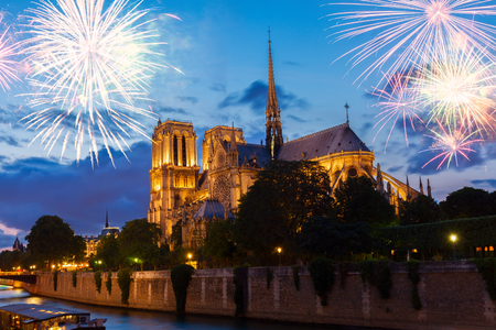 Notre Dame cathedral illuminated at blue night with fireworks, Paris, France