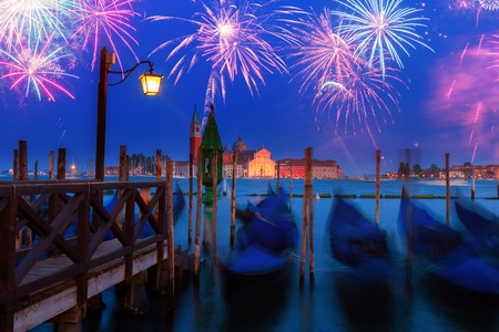 Blured Gondolas motion in the Grand Canal at night with fireworks, Venice, Italy