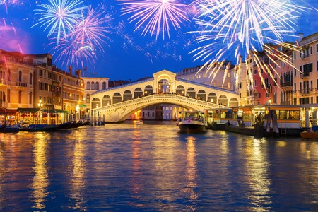 View of famous Rialto bridge at night with fireworks, Venice, Italy