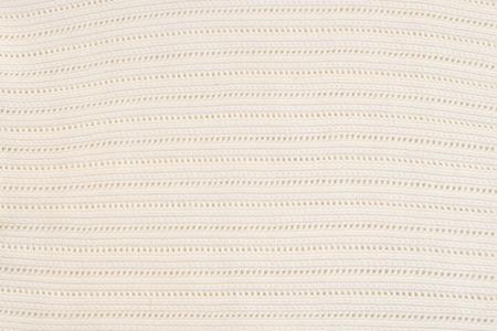 Texture of white plain woolen sweater close up