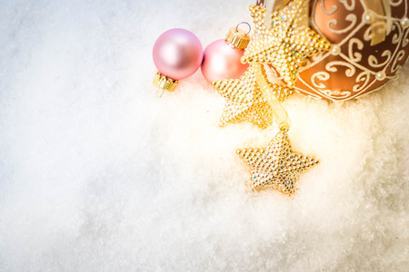 White christmas with snow - pink and golden decorations with copy space, retro toned Reklamní fotografie