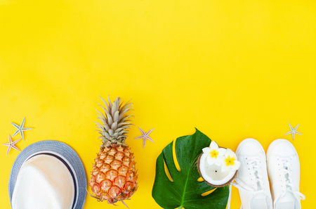 Summer flat lay border with green leaves, cocnut and shoes with copy space Stock Photo