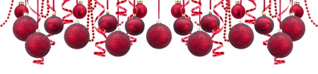 Row of red and golden christmas balls with garlands wide banner isolated over white background Standard-Bild