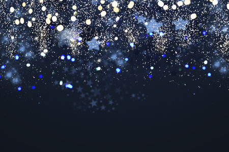 christmas glittering lights bokeh on dark blue background
