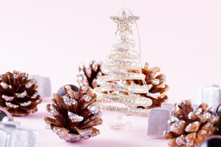Christmas tree with cones on pink