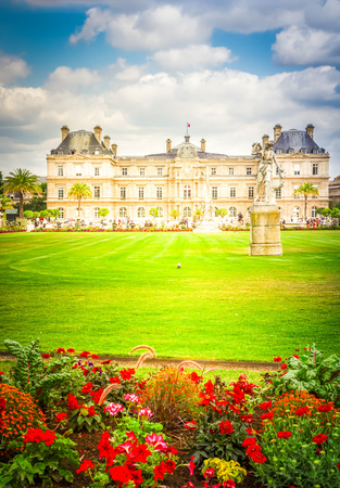 Luxembourg garden with green lawn and flowerbed, Paris, France, retro toned