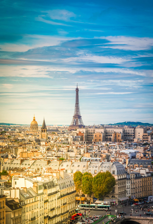skyline of Paris city with eiffel tower landmark from above in soft morning light, France, retro toned
