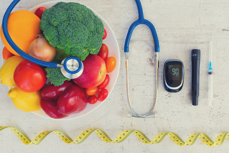 raw vegetables and fruits with blood glucose meter and insulin syringe, diabetes healthy diet concept, retro toned