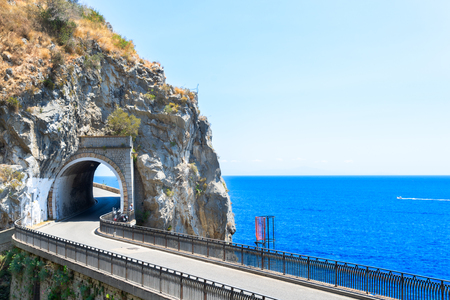 Famous picturesque road viaduct of Amalfi summer coast with sea water, Italy