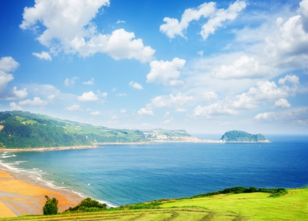 beach of Zarauz at summer day under blue sky, Pais Vasco Spain, toned