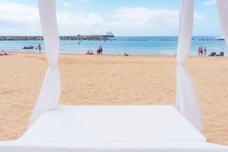 Relaxation area. Spa on the beach with balinese spa bed Stock Photo