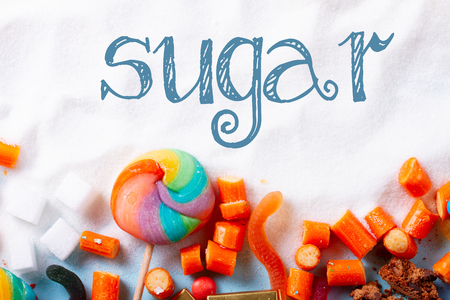 Sweets and candies with sugar, flat lay with word sugar