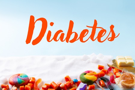 Sweets and candies with sugar, on blue background with word diabetes