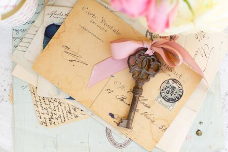 antique rusty skeleton key and watch on handwritted mail