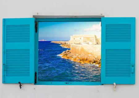 Heraklion harbour with old venetian fort, view through window sills, Crete, Greece 写真素材