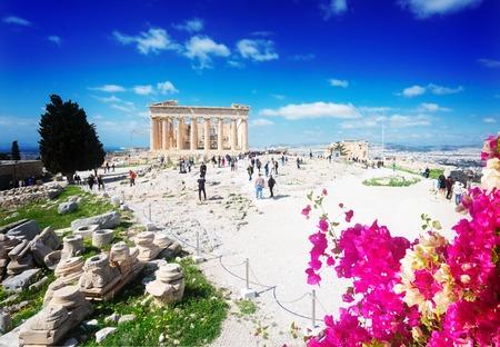 famous Parthenon temple and Athenian Acropolis, Acropolis hill with flowers, Athens Greece