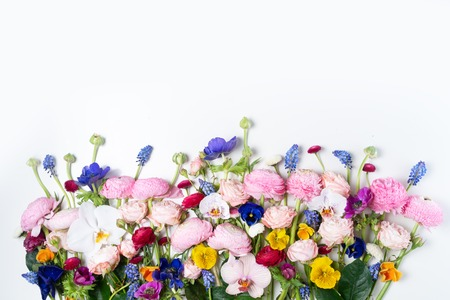 Flowers composition. Border made of roses, ranunculus, pansies and orchids flowers on white background. Flat lay, top view scene. 版權商用圖片