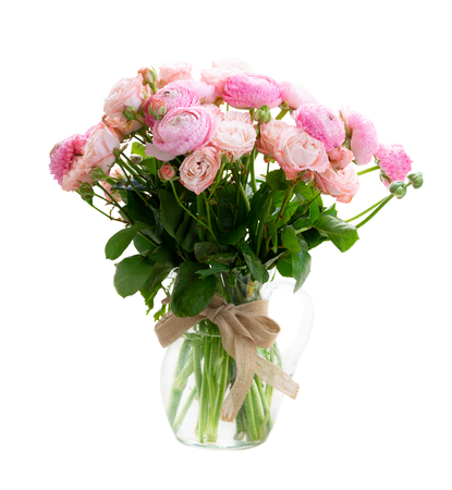 Rose and rununculus flowers bouquet in vase isolated on white background