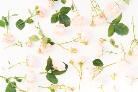 Flowers composition. Pattern made of rose flowers on white background. Flat lay, top view scene.