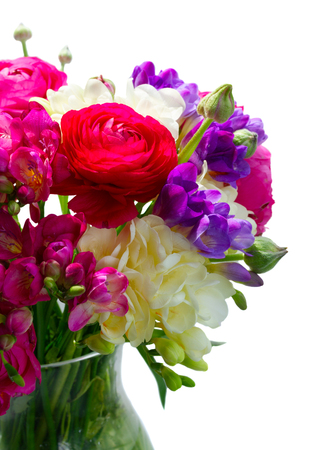 Bouquet of freeseia and ranunculus fresh flowers close up isolated on white background