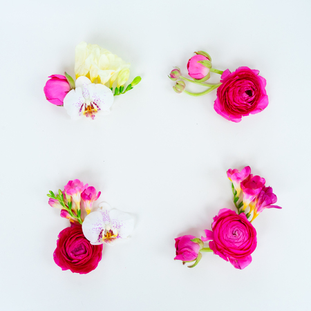 Flowers composition. Frame made of ranunculus and orchidea flowers on white background. Flat lay scene with copy space