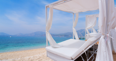 Relaxation area. Spa on the summer beach with spa bed Stock Photo - 122632002