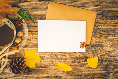 white card fall invitation, leaves and coffee on wooden autumn background, retro toned Zdjęcie Seryjne - 122632063