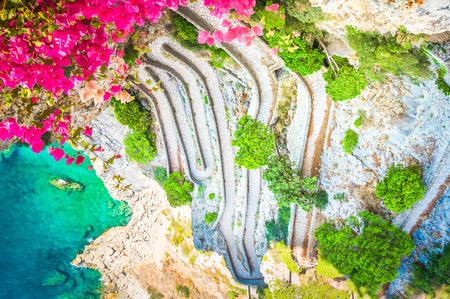 Via Krupp stairs to sea with flowers, Capri island, Italy, retro toned 版權商用圖片