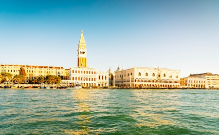 view of famous San Marco square embankment and lagoon waterfront at sunny spring day, Venice cityline, Italy, retro toned