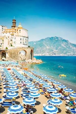 Amalfi town and summer Atrani beach with umbrellas , Italy, retro toned Banque d'images - 122633274