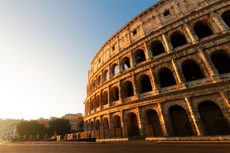 ruins of Colosseum view at sunrise light in Rome, Italy