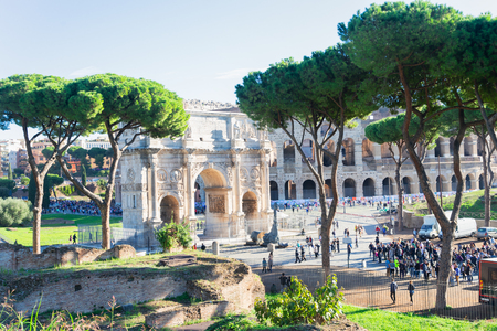 Arch of Constantine and Colosseum at summer day, antique Rome city, Italy Imagens