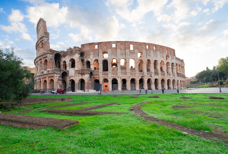 ruins of antique Colosseum building with grass lawn, Rome Italy Imagens