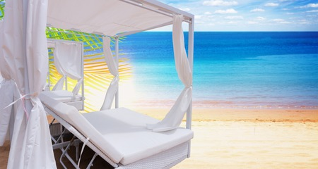 Relaxation area. Spa on the beach with spa bed Stock Photo - 124709527