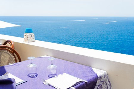 Dinner tables near sea, Beautiful details of Amalfitana at summer, Amalfi coast Italy Banco de Imagens