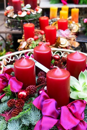 Decorated red advent candles, christmas market shop in Vienna