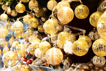 Christmas market kiosk details with wide choice of christmas golden tree decorations