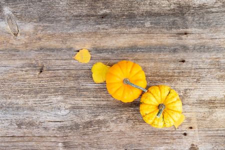 two orange raw pumpkins on old wooden textured table, top view Stok Fotoğraf